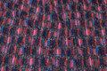 Fyldig strik i lilla og pink farver med flot mønster
