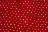 Rød bomuld med trykte guldstjerner på 1 cm