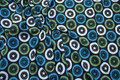 Sort bomuldsjersey med turkis og olivenfarvede cirkler