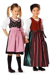 Smart dirndl in two different lengths and fabrics, with matching aprons. The blouse either with short puff sleeves or with long, slim sleeves.