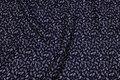 Polyester mousselin i sort med sandfarvet mønster