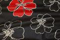 Sort teflonbehandlet textildug med store blomster