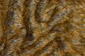 Meget flot, imiteret pels i gyldne farver