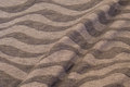 Bølgestribet jerseystrik grå tone-i-tone
