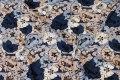 Blomstret viscosejersey i blå og sand nuancer
