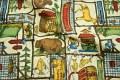 Vildmarksliv patchwork med bjørne, hjorte, telte, mad m.m.