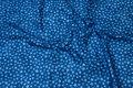 Blå batikbomuld med små stjerner