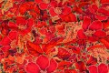 Patchwork-bomuld i rød og guld og blomstermønster