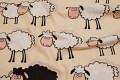 Beige børnebomuld med søde får