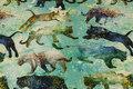 Turkisgrøn bomuldsjersey med rovdyr på spring