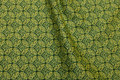Patchworkbomuld med fint mønster i grønne farver