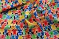 Røde, blå, gule og grønne katte på række