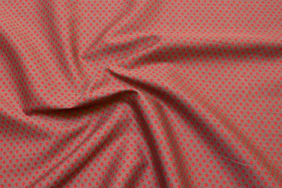 Bomuldspoplin med prikker i orange og jordbrun