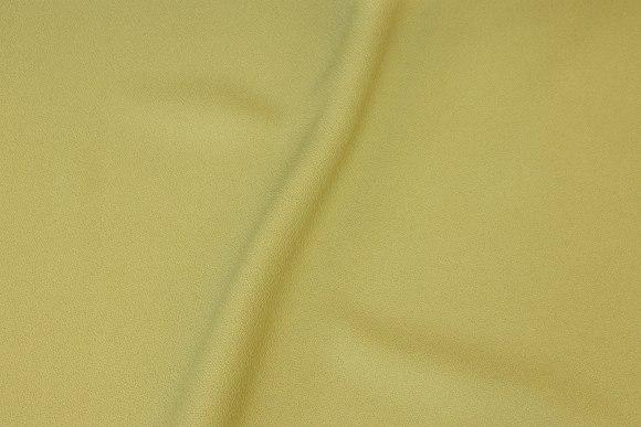 Æblegrøn polyester med let creppet overflade