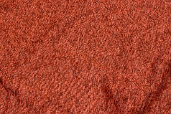 Blød meleret vinterstrik i brændt orange