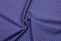 Bomuldspoplin med prikker i blå og jordbrun.