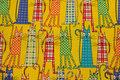 Gul patchwork-bomuld med sjove katte