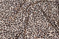 Let polyester-jersey i sandfarvet med lille dyretryk
