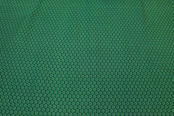Græsgrøn vævet bomuld med lille trykt mønster