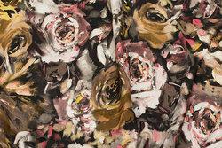 Bomuldsjersey i brungyldne farver med roser