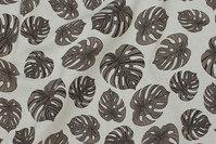 Deko-stof i hørlook med jordfarvede filodendron blade