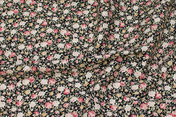 Fast, sort bomuld med små roser i sand og rosa