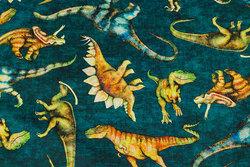 Mørkgrøn patchwork-bomuld med dinosaurer