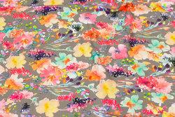 Sandfarvet bomuldsjersey med coral og pink blomster