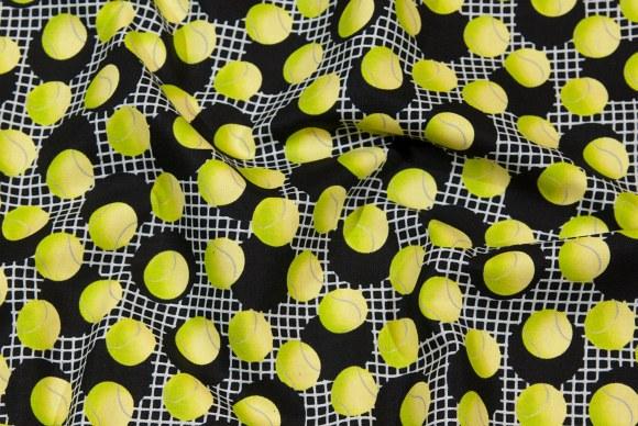 Sort-lime patchworkbomuld med tennisbolde