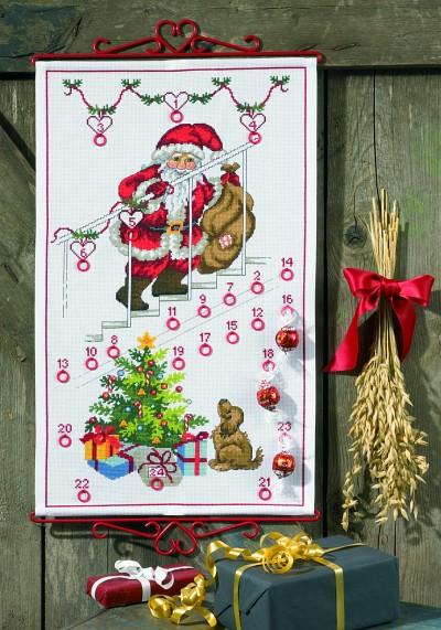 Hvid pakkekalender med Julemanden på trapper