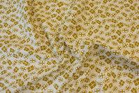 Råhvid bomuld med guldpakker