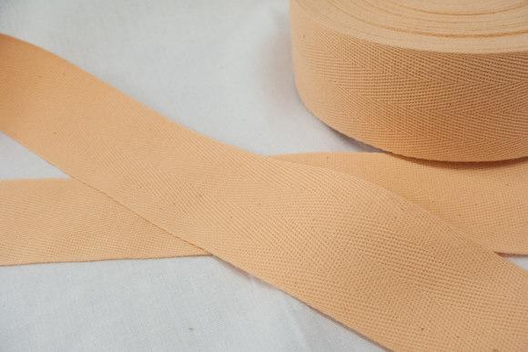 Sildebensvævet bomuldsbånd 4 cm laks