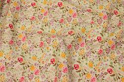 Off white bomuld med små blomster i rød og gul