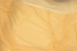 Tyndt, transparent strækbart mesh i lys hudfarve
