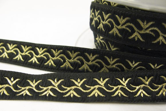Bånd sort/guld bladmønster 1,7cm