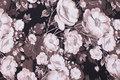 Sort bomuldsjersey med roser i rosa og koksgrå.