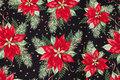 Sort patchwork-bomuld med julestjerner i rød, grøn og guld.