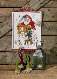 Julepakkekalender med julemand og lille dreng