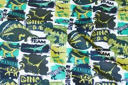 Bomuldsjersey med dinosaurer i grønne nuancer