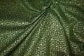 Grøn patchworkbomuld med guld-stjernemønster.