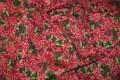 Rød-grøn patchworkbomuld med blomstret tjørnetryk.