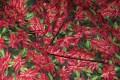 Rød-grøn patchworkbomuld med blomstret tjørnetryk