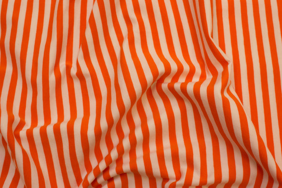 Tværstribet, gennemfarvet bomuldsjersey i orange og hvid