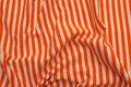 Tværstribet, gennemfarvet bomuldsjersey i orange og hvid.