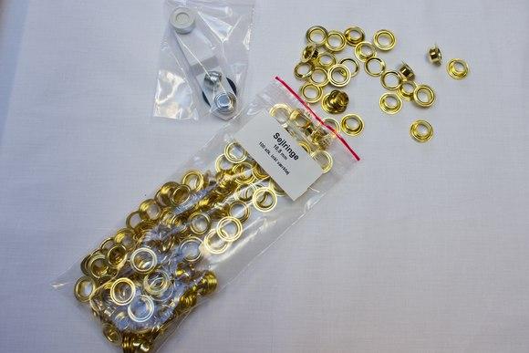 50 stk. sejlringe,10,5 mm, guldfv.  incl. værktøj