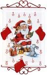 Permin 34-2525. Hvid pakkekalender med julemanden der læser højt.