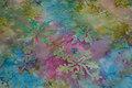 Batik-bomuld i turkis og pink med spredte blade