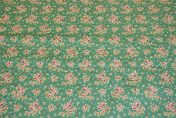 Jadegrøn bomuld med små rosa blomster
