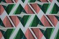 Kraftig bomuld i off white med grafisk mønster i grøn og coral.