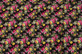 Black cotton with pink and yellow roses.